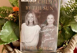 """Carly Simon's """"Touched by the Sun"""" is More than a Quirky Love Letter to her Friend Jackie O"""